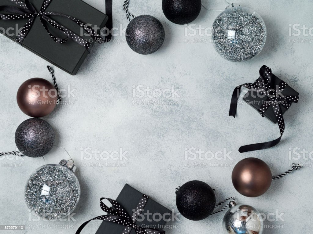 Christmas background with gift boxes and decorations in black and silver colors. View from above. Flat lay stock photo