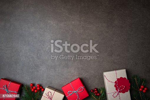 istock Christmas background with gift boxes and decorations on dark background 870582540