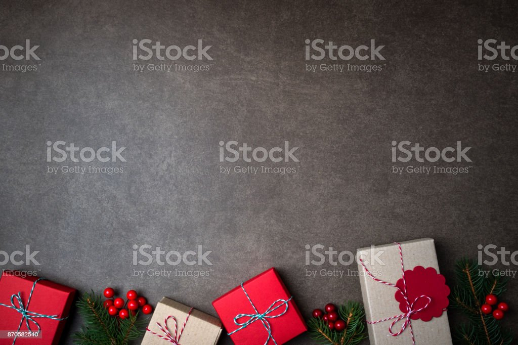Christmas background with gift boxes and decorations on dark background stock photo