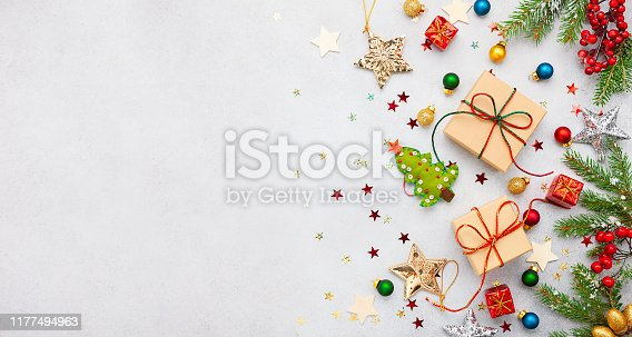 Christmas background with gift boxes, festive decor, fir tree branches. Flat lay. Christmas and New Year concept.