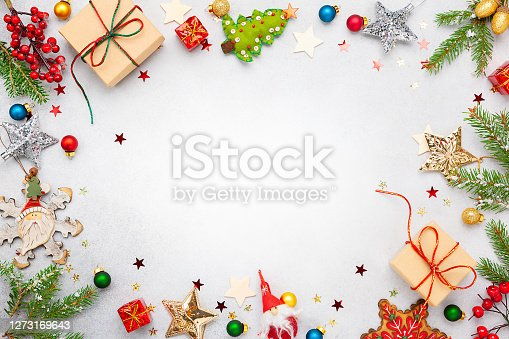Christmas background with gift boxes, festive decor, fir tree branches and paper cards notes. Flat lay. Christmas and New Year concept.