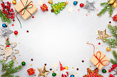 istock Christmas background with gift boxes, festive decor, fir tree branches 1273169643
