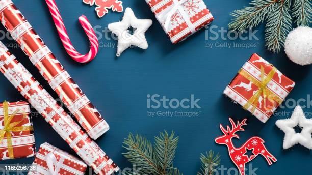 Christmas background with gift boxes pine tree branch paper wrapping picture id1185256736?b=1&k=6&m=1185256736&s=612x612&h=u6wpsanv4zfn2wzko6 qvby8vx47w2nt1nics16diz0=