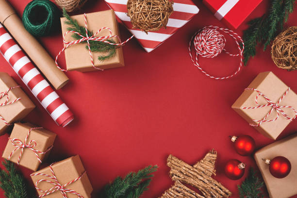 christmas background with gifts and decorations. - avvolto foto e immagini stock