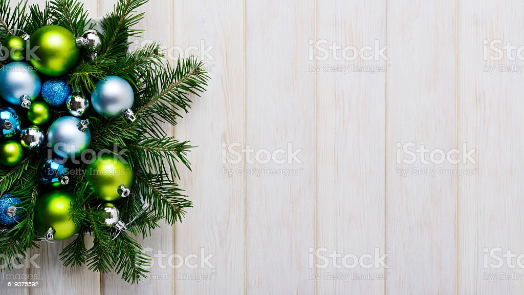 Christmas background with green and blue ornaments stock photo