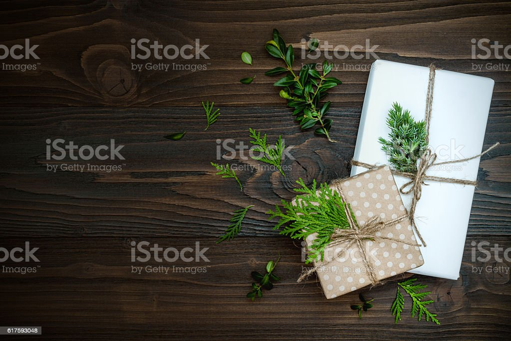 Christmas background with hand crafted presents  on rustic wooden table