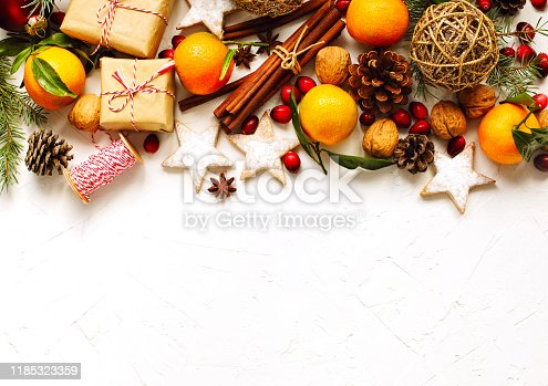 Christmas background with holiday decoration and gifts, top view, frame