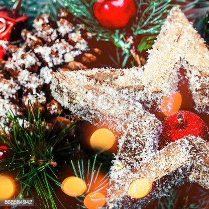 846933050istockphoto Christmas background  with holiday decorations and bokeh lights  in vintage style with copy space 868584942