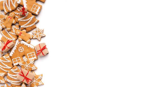weihnachten hintergrund mit hausgemachten lebkuchen und kleine geschenke - backrahmen stock-fotos und bilder