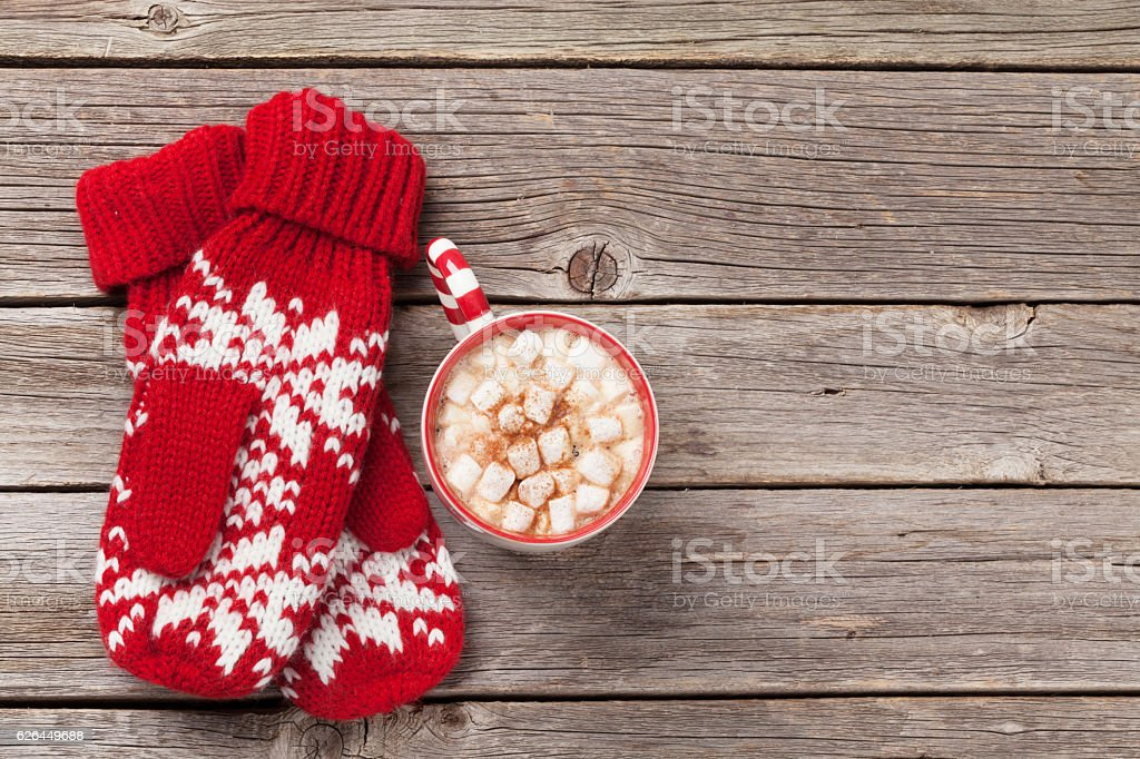Christmas background with mittens, hot chocolate stock photo