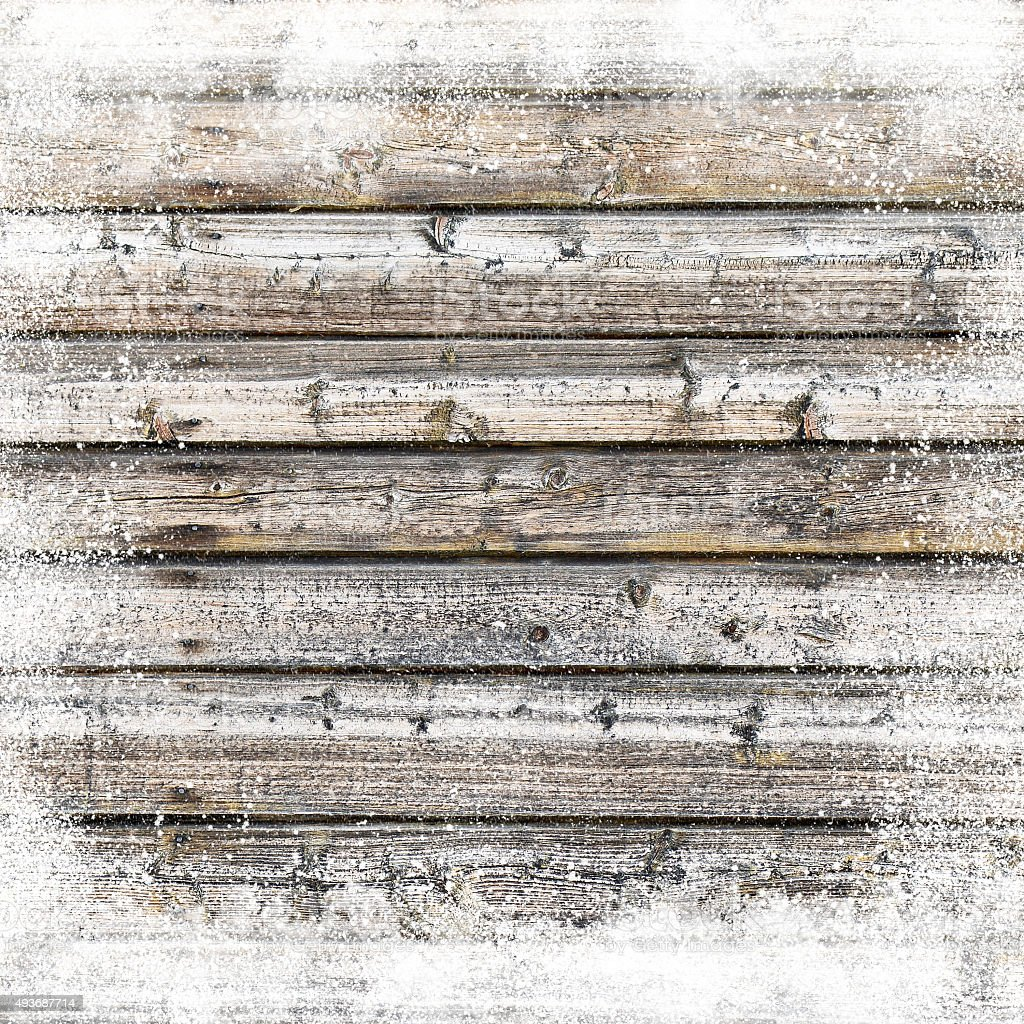 Christmas background with old wooden planks and snow flakes stock photo