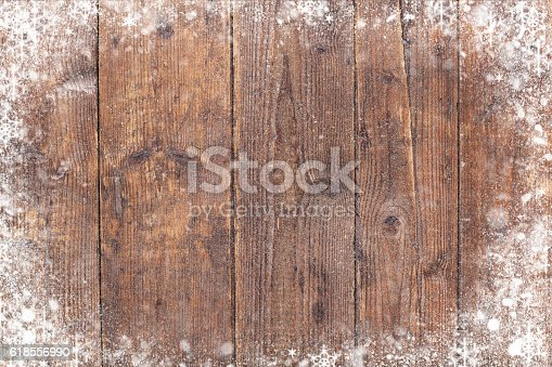 Christmas background with old wooden planks and snow flakes