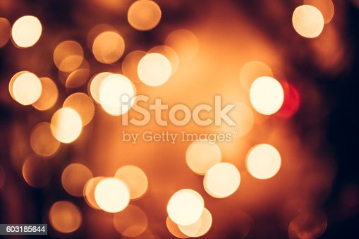 istock Christmas background with orange bokeh from candle lights 603185644