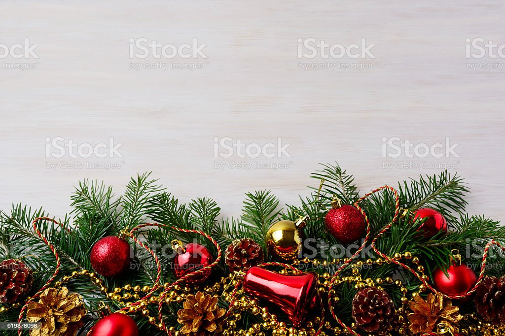 Christmas background with pinecone, golden and red ornaments stock photo