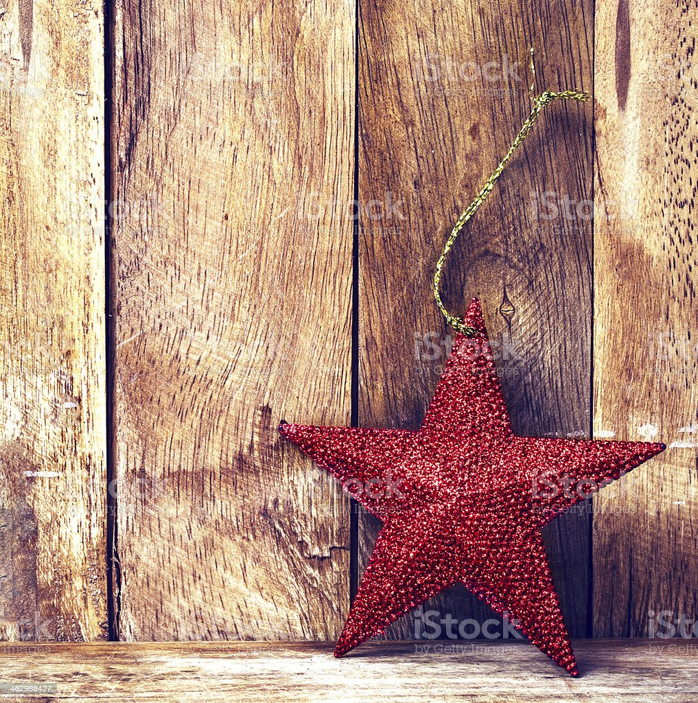 Christmas background with red star and snowflakes on old  wooden royalty-free stock photo