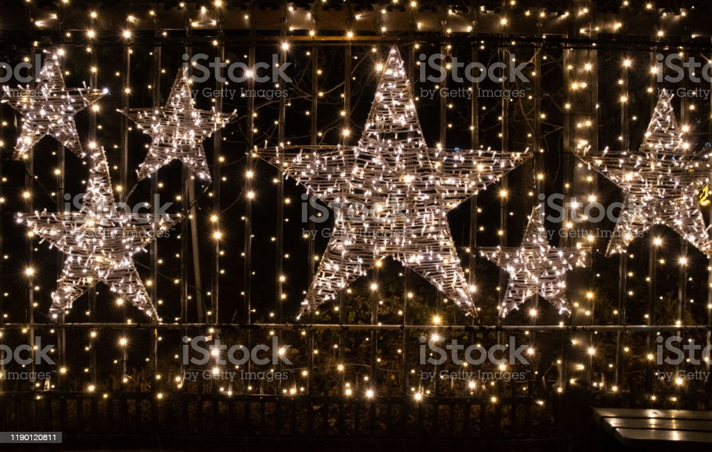 Christmas Background With Shiny Stars And Sparkling Christmas Lights Decorations With Lights Garlands Abstract Backdrop Outdoor New Year Decorations With Glowing Stars Stock Photo Download Image Now Istock