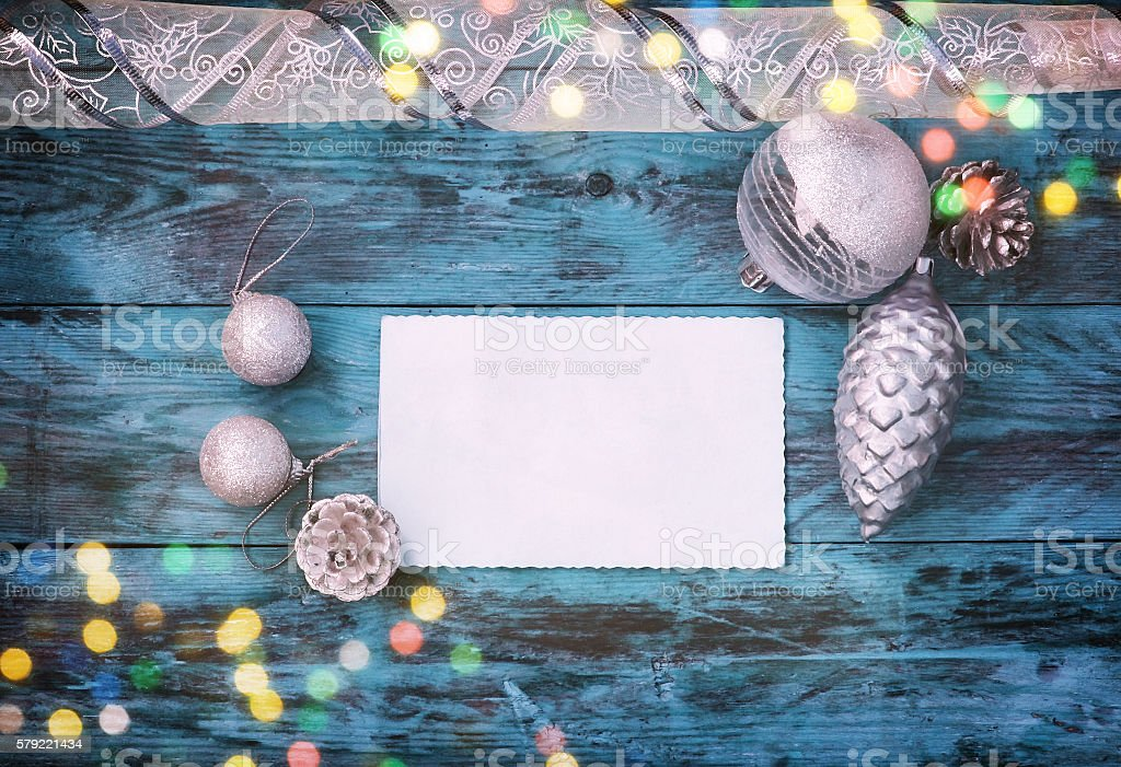 Christmas background with silver balls, cones, ribbon stock photo