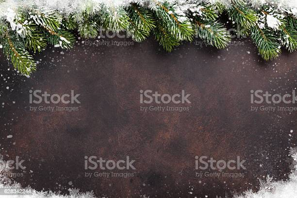 Photo of Christmas background with snow fir tree