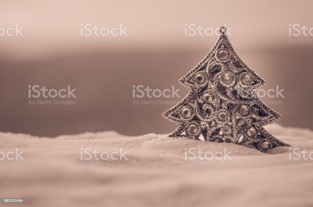 8400a6d46ec Christmas background with snowy fir trees. Snow Covered Christmas Tree  stands out brightly against blurred