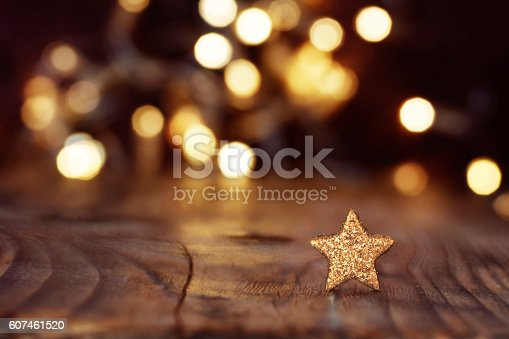 istock Christmas background with stars and bokeh 607461520