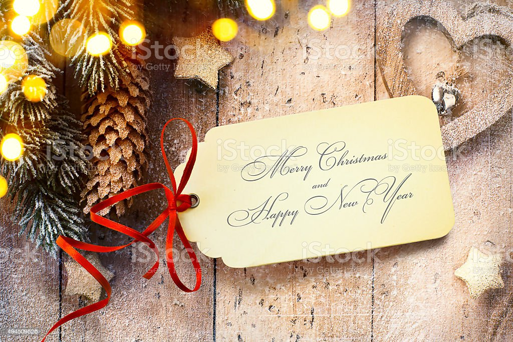 Christmas background with tree light and Christmas paper card stock photo