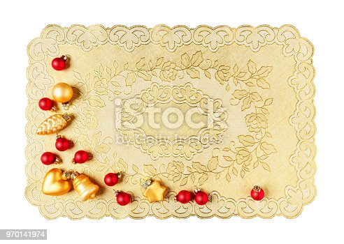 Christmas decoration with vintage plastic placemat, red and gold baubles isolated on white background clipping path included. Design element, flat lay