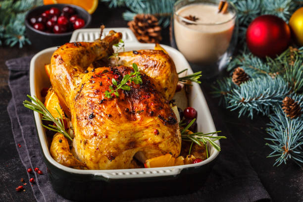 christmas baked chicken with cranberries, orange, spices and herbs. christmas food concept. - peru carne branca imagens e fotografias de stock
