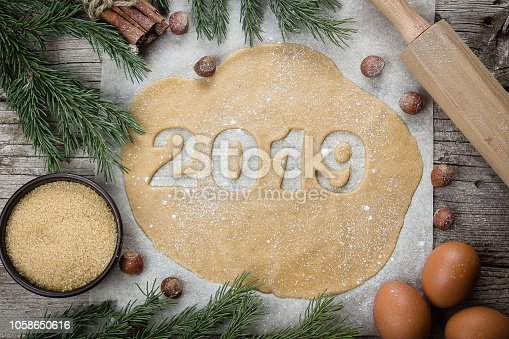 istock Christmas Bakery Concept. Gingerbread raw dough for Christmas cookies. Happy New Year 2019. Top view 1058650616