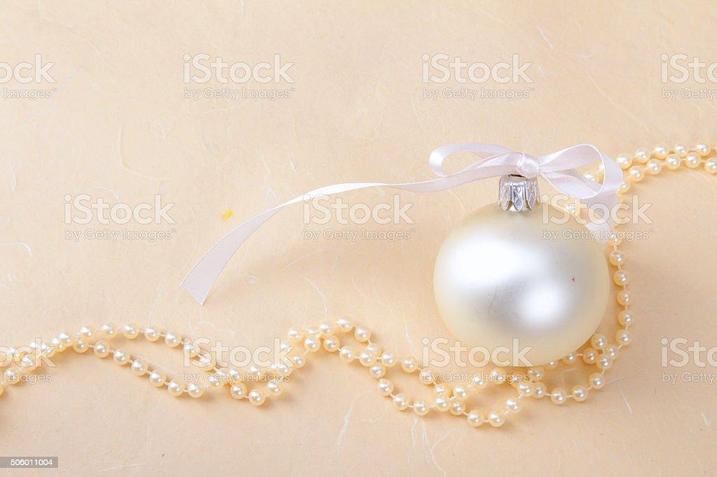 Christmas ball and beads stock photo