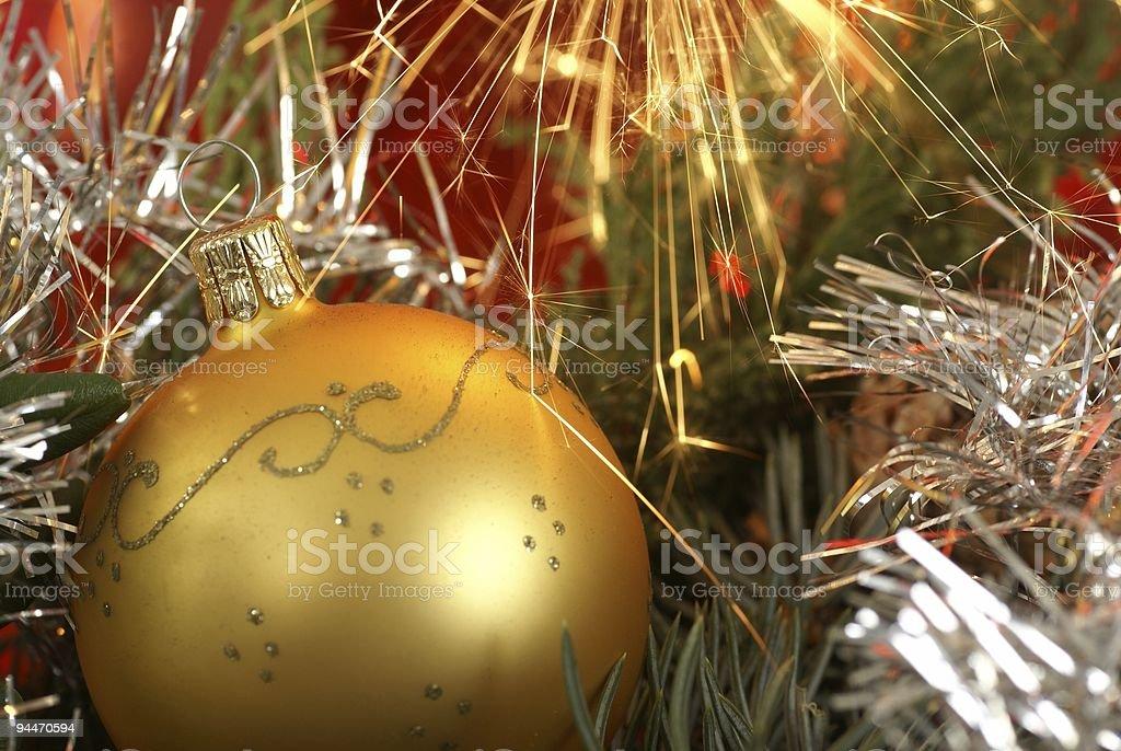 Christmas ball and sparkles royalty-free stock photo