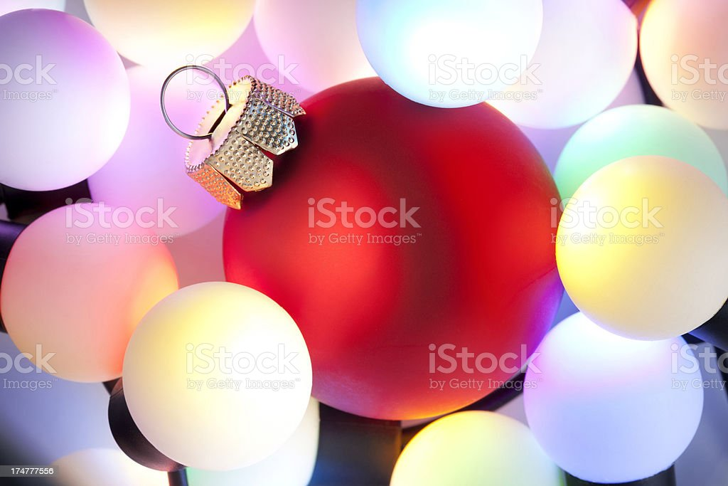 Christmas ball between the lights royalty-free stock photo