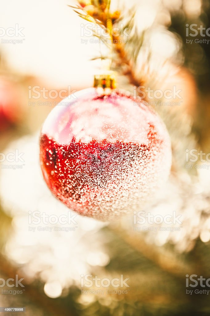 Christmas Ball Decoration Covered with Snow stock photo