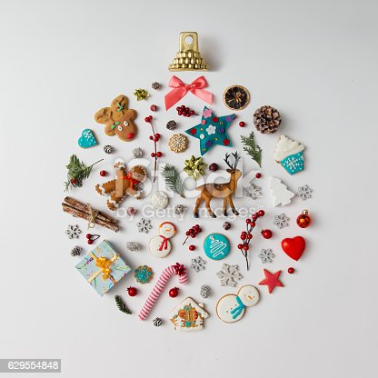 istock Christmas ball made of decoration elements. Flat lay. 629554848