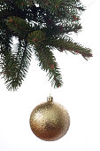 istock Christmas ball on the branch of a fir tree isolated against white 668264588