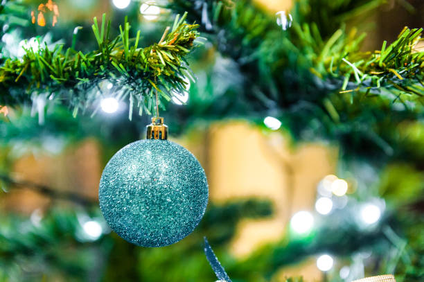 Christmas ball on the tree in the background with other decorations and garlands. copy space stock photo
