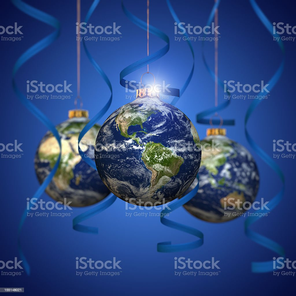 Christmas ball with Earth texture, blue cgristmas balls and ribbons royalty-free stock photo