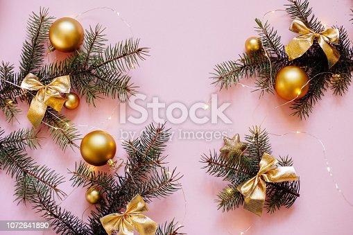 istock Christmas balls and Christmas tree branches. 1072641890