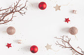 istock Christmas balls, beige and red decorations. Flat lay, top view 892022494