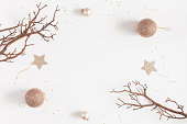 istock Christmas balls, beige decorations. Flat lay, top view 892673768
