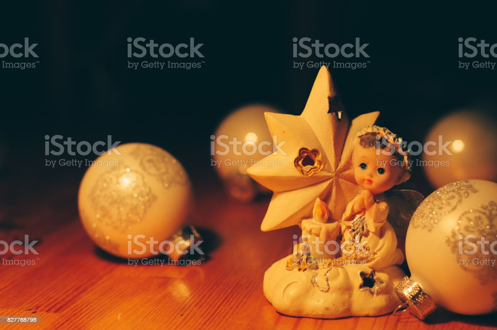 Christmas balls composition on wood surface. Lights to darkness stock photo