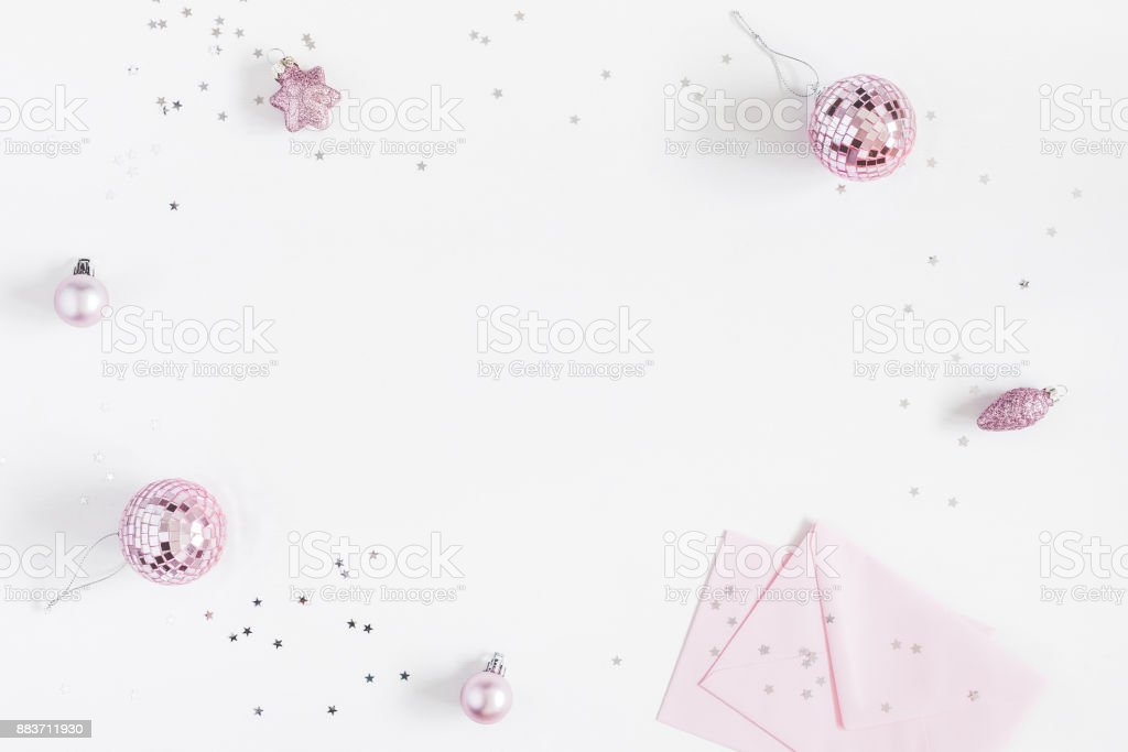Christmas composition. Christmas balls, envelopes, pink and silver...