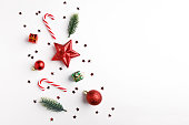 istock Christmas balls, fir tree branches and Christmas ornament on white background. 1178921448