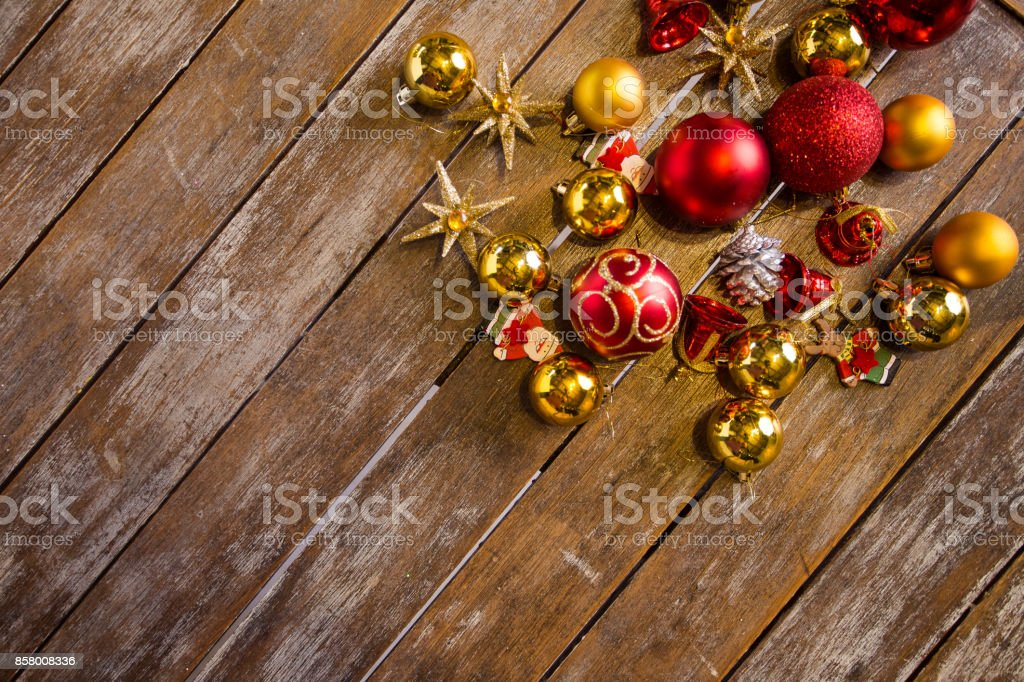 Christmas balls laying on a wood table ready to be hung. stock photo