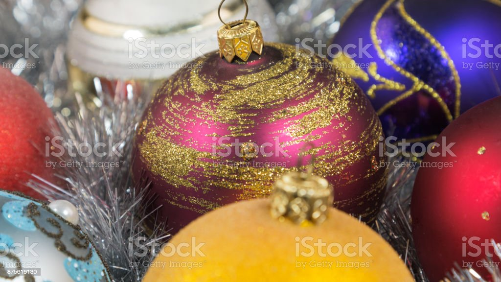 christmas balls on a silver tinsel background christmas toy with christmas tinsel christmas decorations