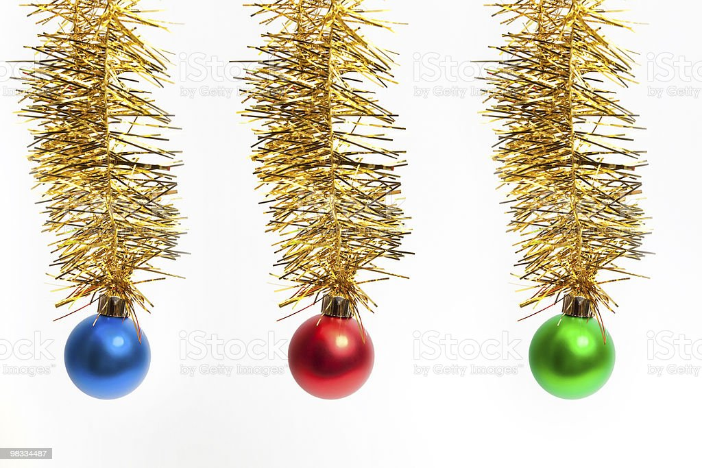 christmas balls on tinsel royalty-free stock photo