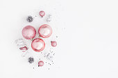 Christmas balls, pink and silver decorations. Flat lay, top view
