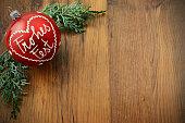 istock Christmas balls with german words Frohes Fest Merry Christmas and pine tree twigs. Copy space 1078482590