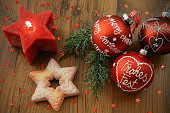 istock Christmas balls with german words Frohes Fest Merry Christmas and pine tree twigs. 1078482696