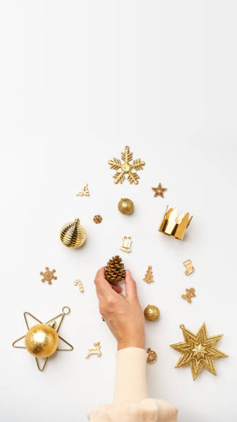 christmas banner background.woman hand decoration golden color xmas items in christmas tree shape on table.vertical mockup banner 16-9 ratio for advertise on mobile social media - golden ratio zdjęcia i obrazy z banku zdjęć