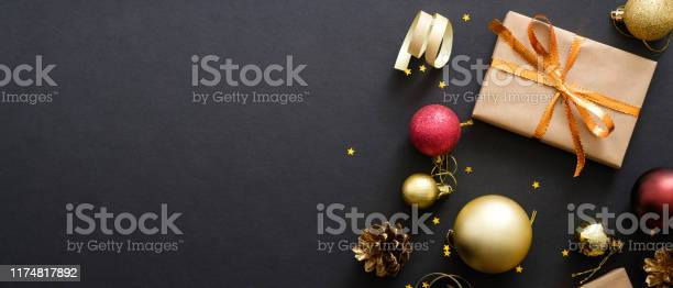 Christmas banner black xmas background with decorations gifts box picture id1174817892?b=1&k=6&m=1174817892&s=612x612&h=yauu7duzdefjgrzjtqa22lnqpoaxtxi867ec2wgz21i=
